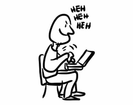 man chuckling as he types